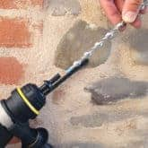 inserting a remedial wall tie into setting tool