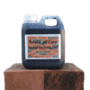 1L jerry can of Total Wall Care Soot Wash standing on half treated brick