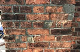 Damaged brick faces and loose pointing