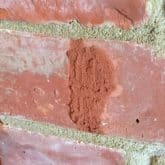 Picture showing cracked brick being repaired with crack repair injection mortar