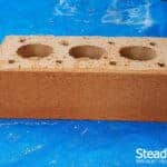 Buff brick with first coat of burnt orange brick tint