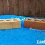 Buff brick compared to burnt orange/coffee brown tinted brick