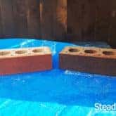 Burnt orange brick in comparison to brick tinted in burnt orange and speckled with coffee brown and carbon black brick tint