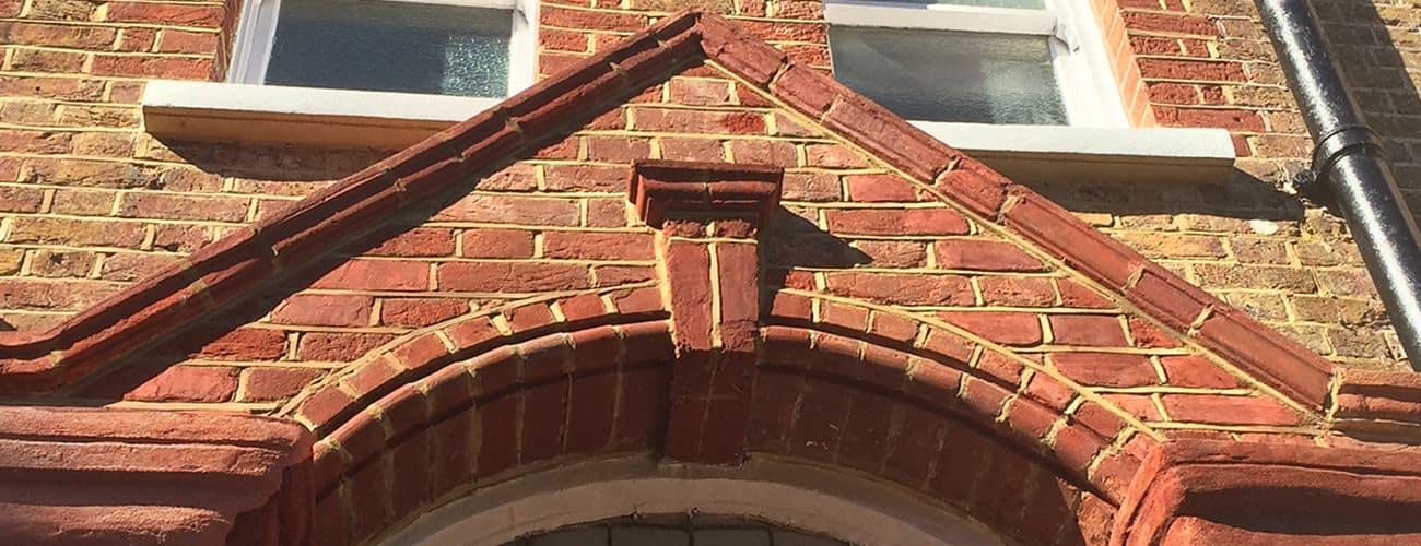Brick porch repaired with Total Wall Care brick repair mortar