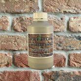 Bottle of Light Grey Mortar Tint against brick wall