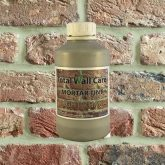 Bottle of Light Khaki Mortar Tint against brick wall