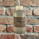 Bottle Smoke Grey Mortar Tint against brick wall
